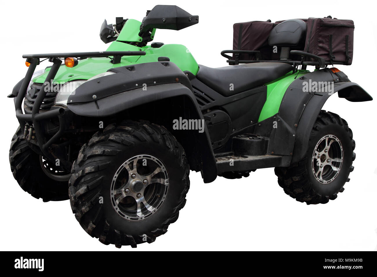 Modern ATV with bags for carrying luggage is isolated on white background. Stock Photo