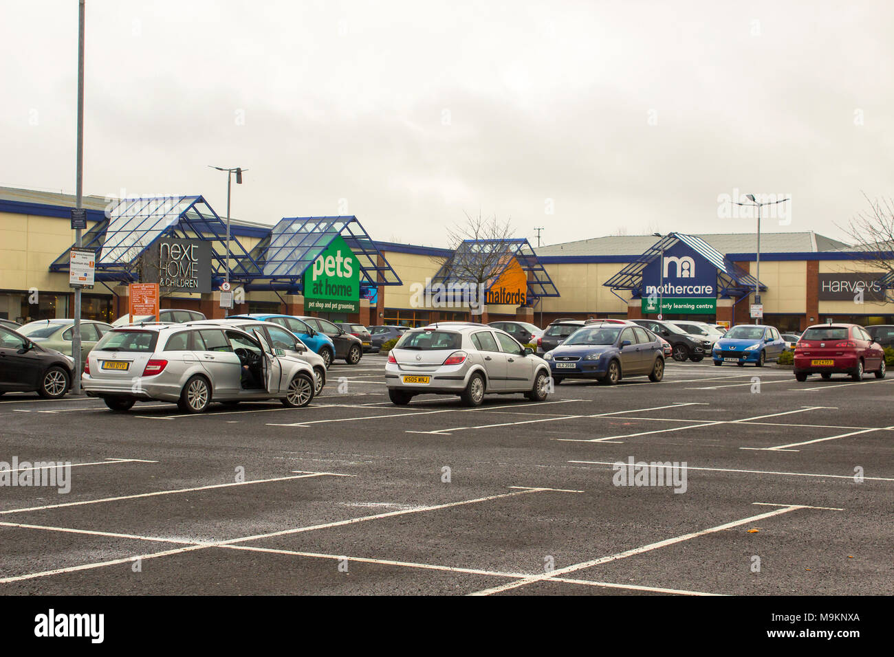 Various retail outlets open for business on a dull spring morning at a local outlet park in Newry County Down Northern Ireland - Stock Image