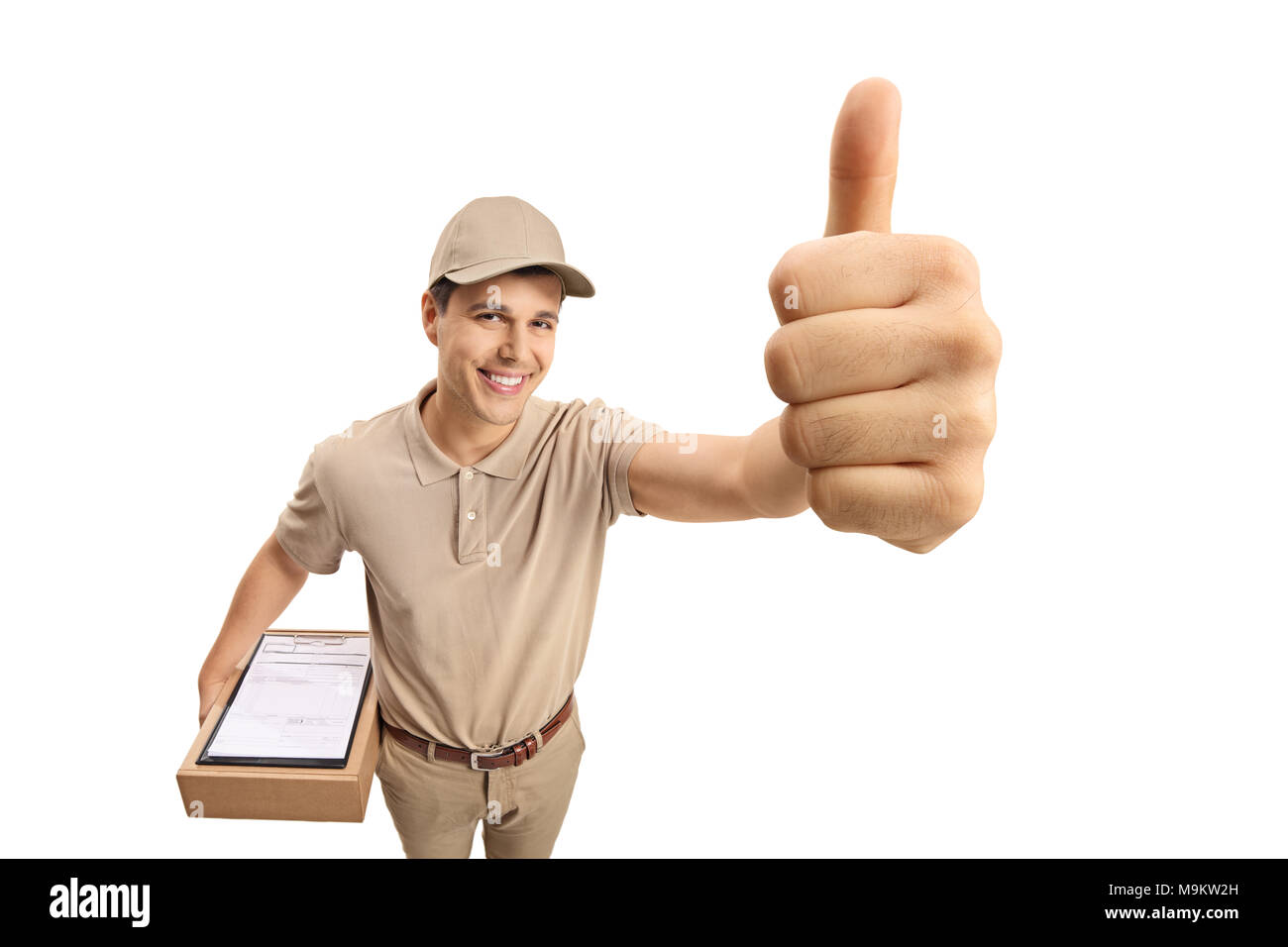 Delivery man making a thumb up gesture isolated on white background - Stock Image