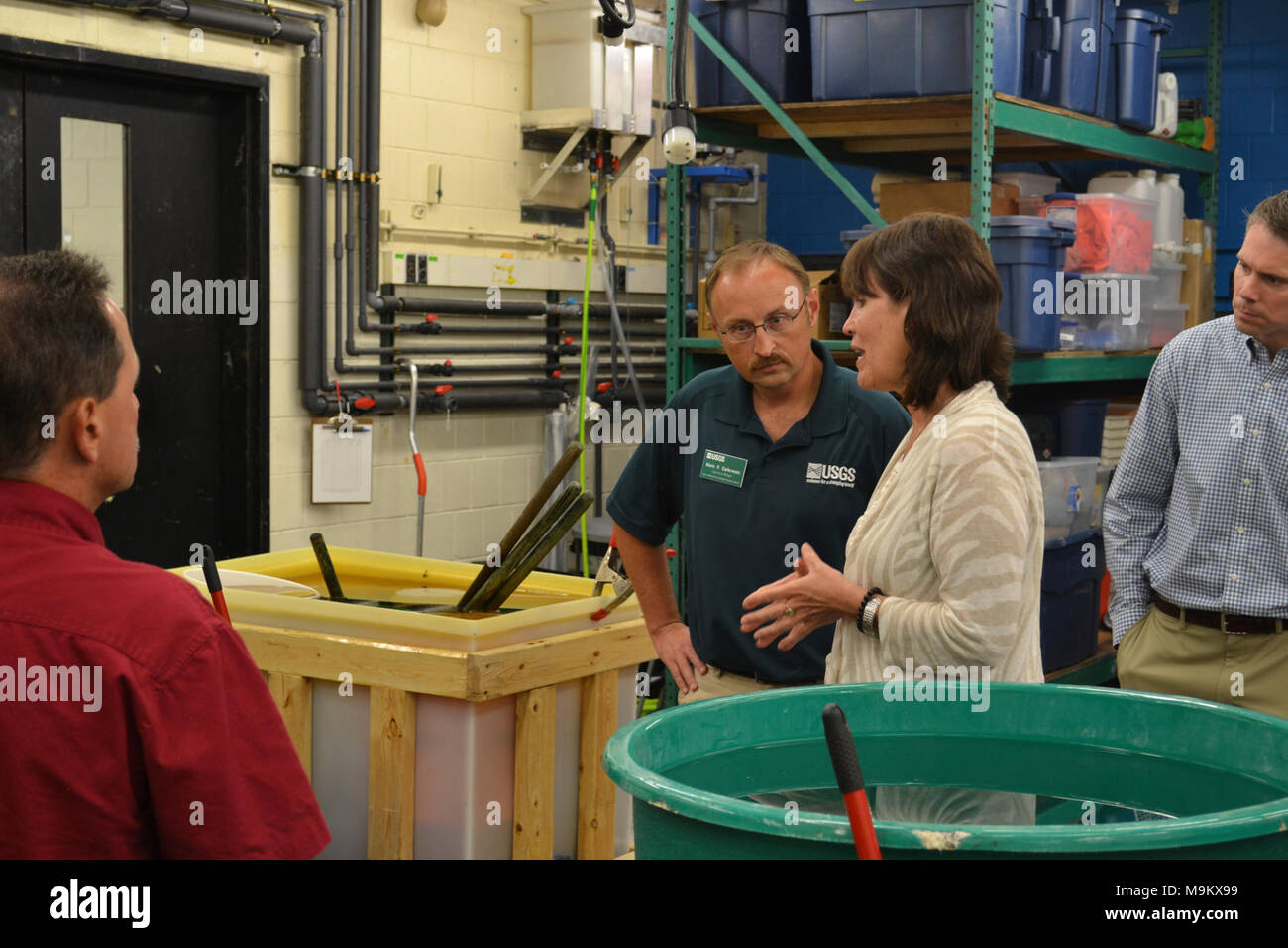 Rep. Betty McCollum (D-Minn.) chats with Mark Gaikowski, a research physiologist with the U.S. Geological Survey (USGS). Photo by Garrett Peterson/USFWS. - Stock Image