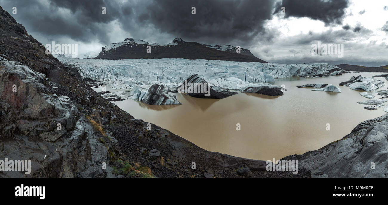 Dramatic Panoramic of Svinafellsjokull Glacier and Hvannadalshnukur Peak in East Iceland Stock Photo