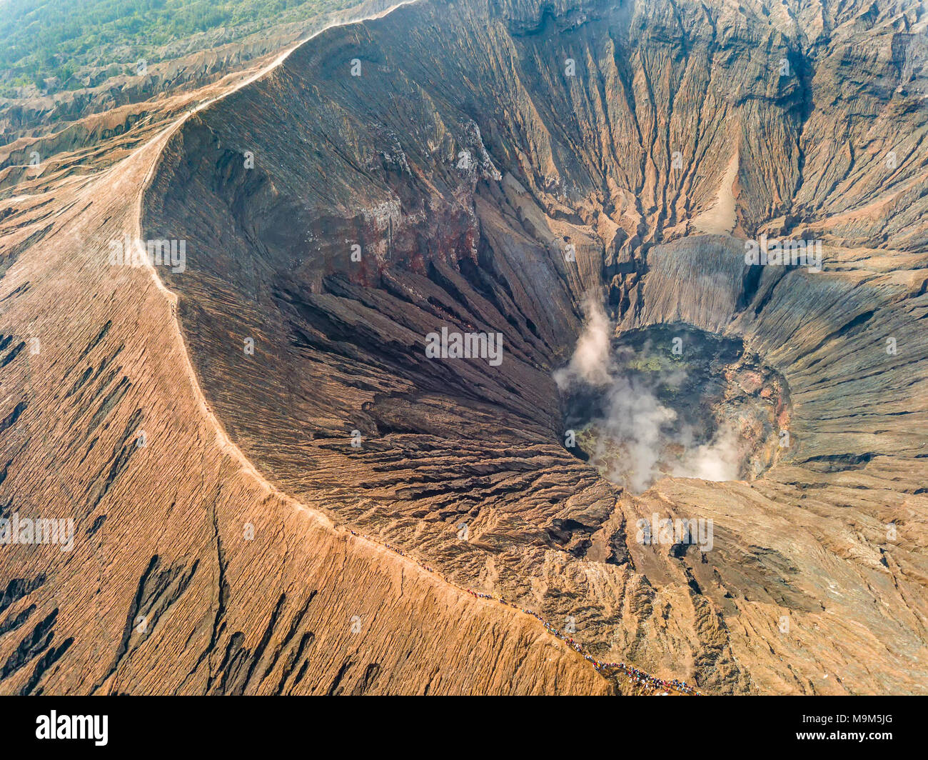 Indonesia. Java island. The active volcano Bromo. Aerial view of the crater and many tourists on the caldera - Stock Image