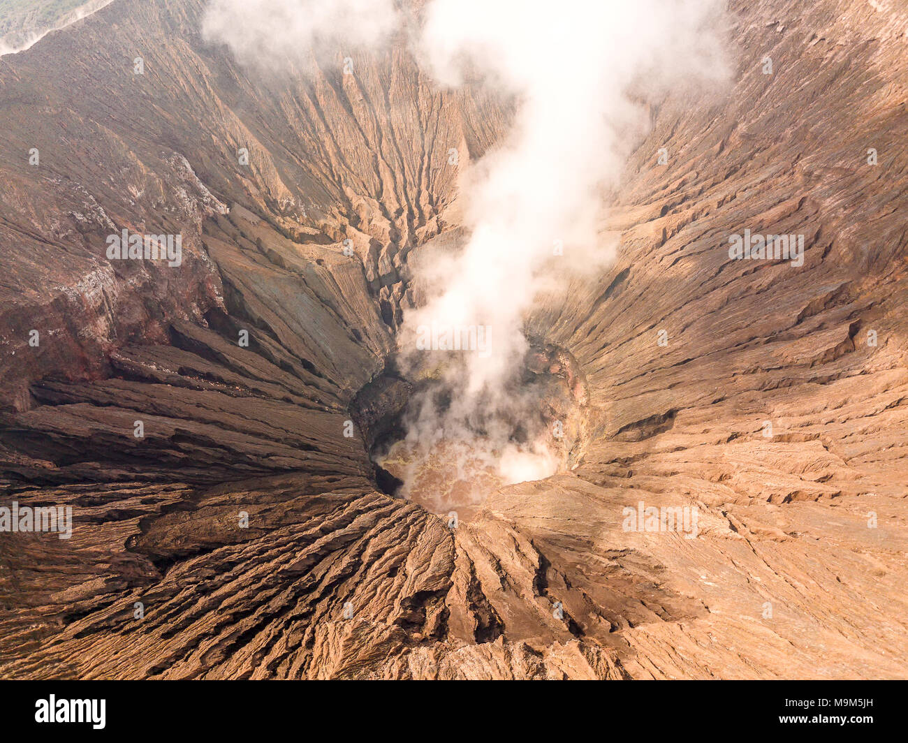 Indonesia. Java island. The active volcano Bromo. Aerial view of the slopes of the crater and smoke - Stock Image