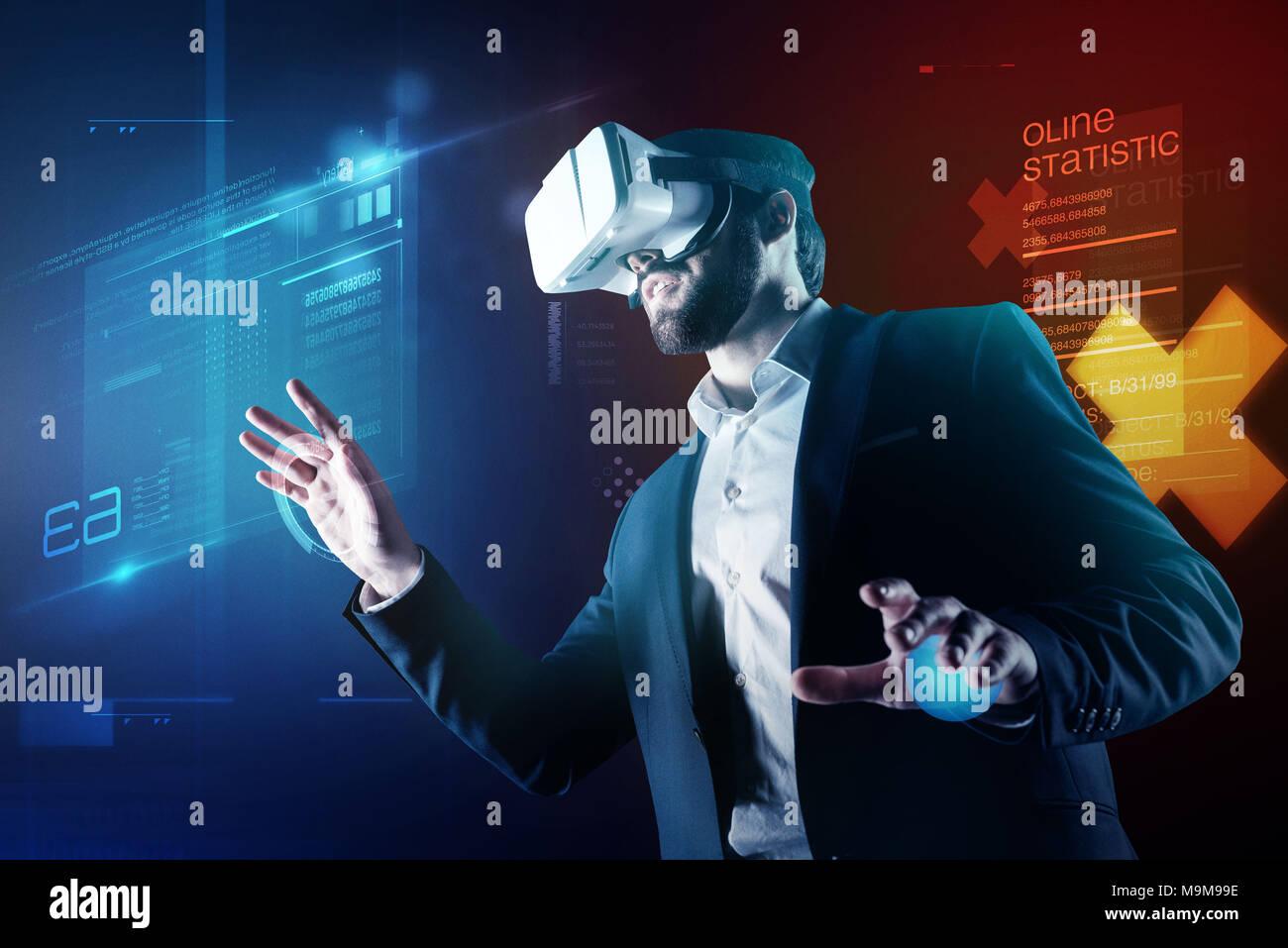Progressive programmer wearing amazing virtual reality device while working - Stock Image