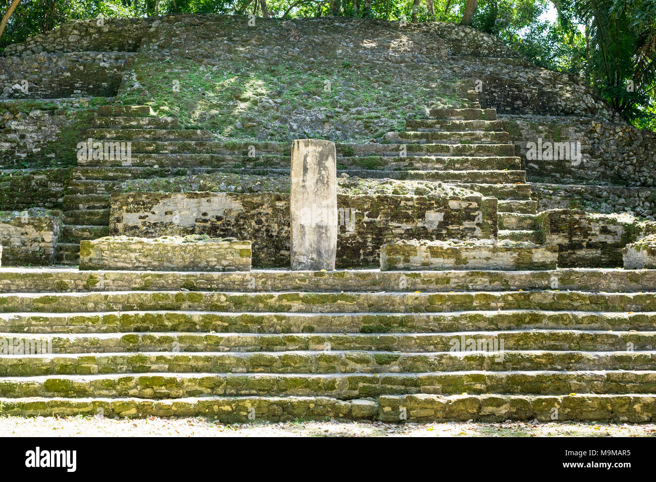Ancient Mayan ruins and temples in the archeological site of Lamanai, Belize, Central America - Stock Image