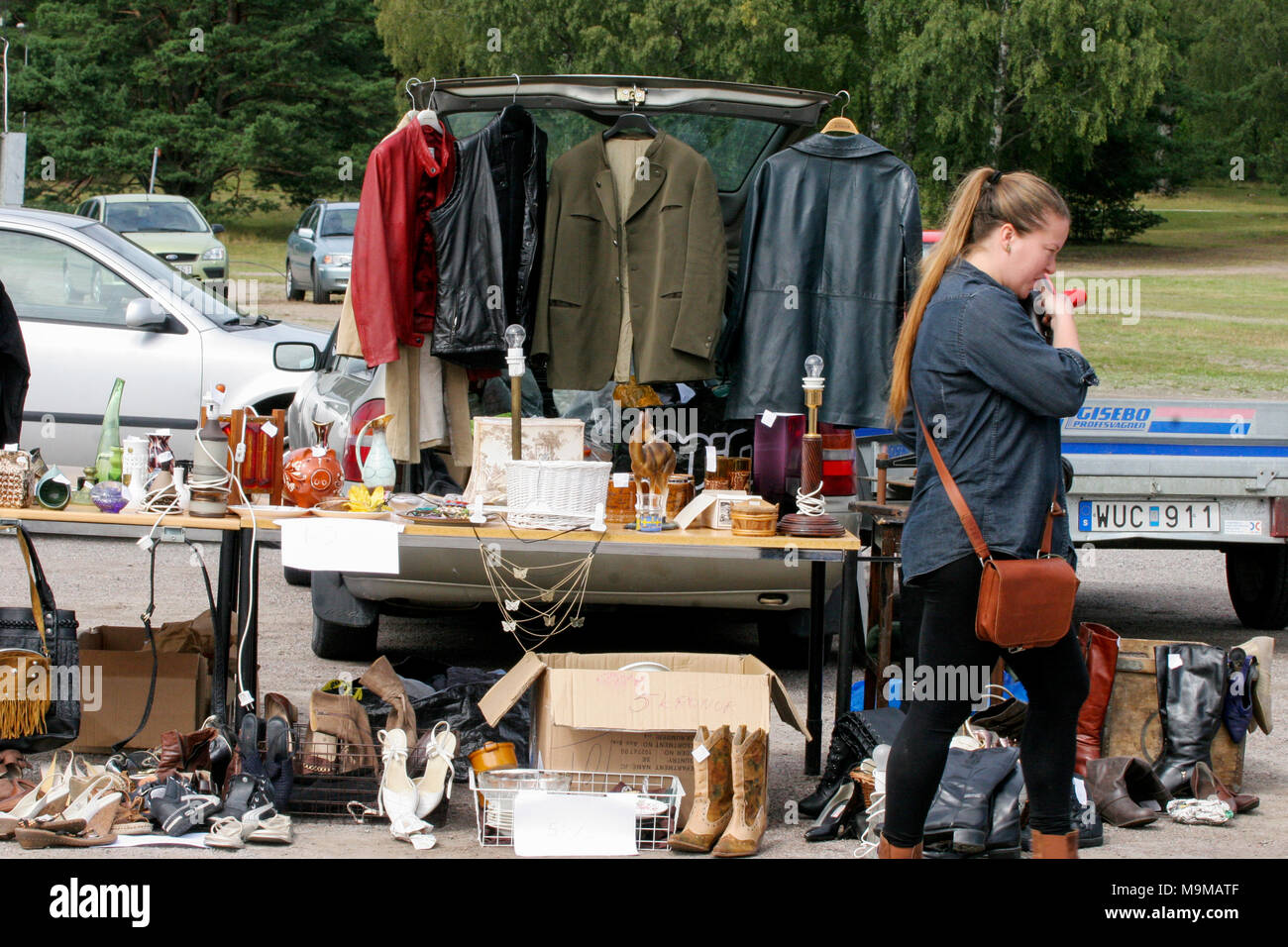 SECOND HAND MARKET  2016 with clothes and old shoes - Stock Image