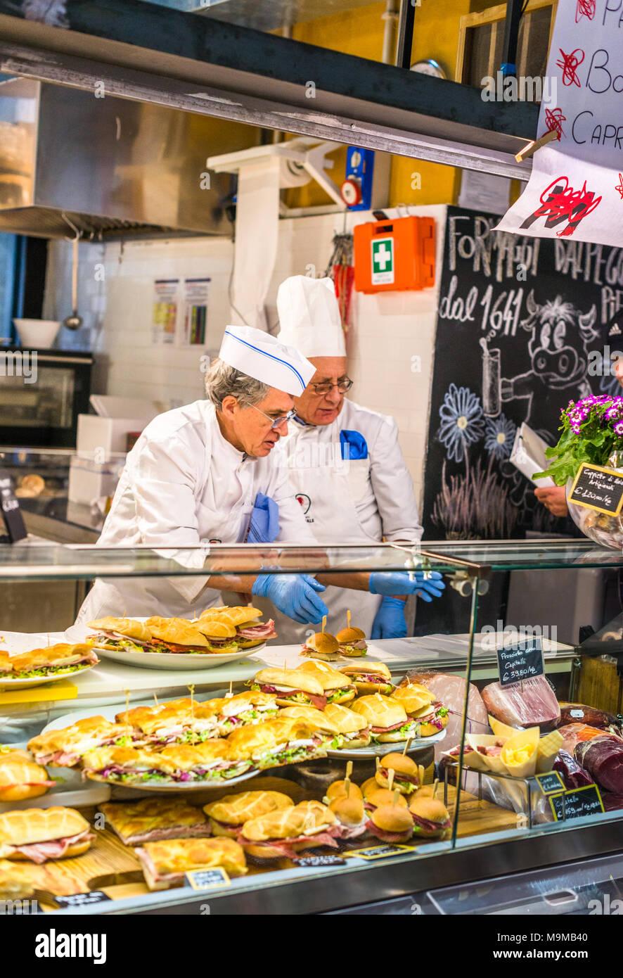 Two Italian men serving sandwiches at Mercato Centrale Roma next to Roma Termini railway station, Rome, Lazio, Italy. Stock Photo
