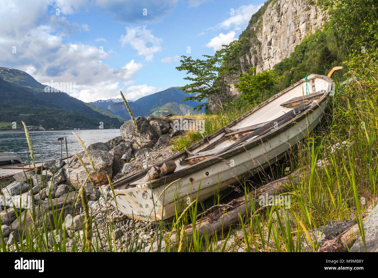rowing boat at the shore, Lustrafjorden, Norway, idyll at the fjord - Stock Image