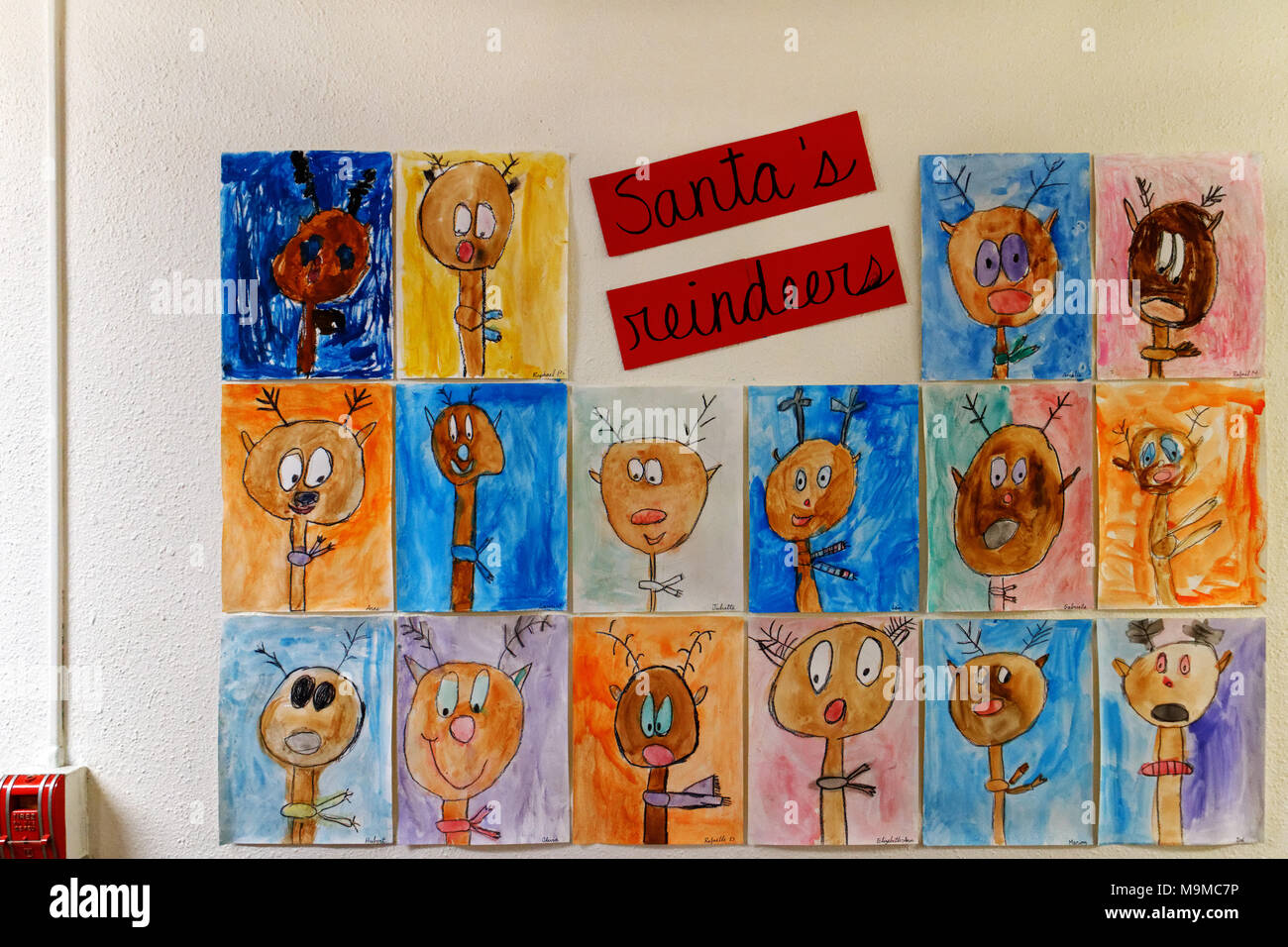 A lovely display of children's drawings of Santa's Reindeer ina school - Stock Image
