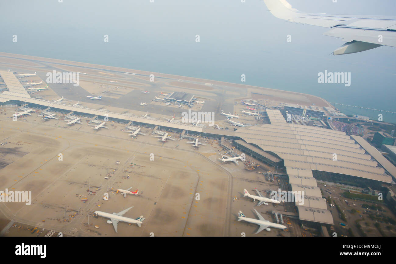 Aerial photography of the international airport with airplanes parking. Hong Kong International Airport. - Stock Image