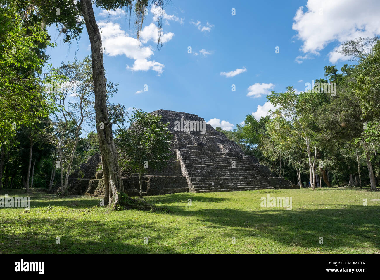 Ancient ruins from the Mayan archeological site in Yaxha, Guatemala - Stock Image