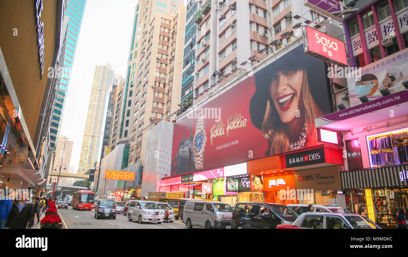 Hong Kong, China - January 1, 2016: Central streets of Hong Kong. Billboards. Shopping centers and fashion shops. High-rise architectural infrastructure. Hotels. Places of entertainment and recreation. - Stock Image