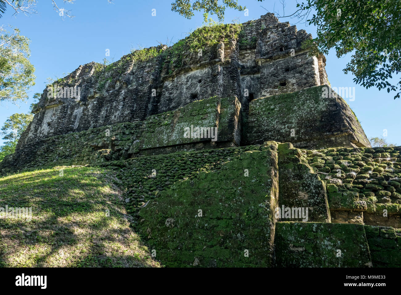 Ancient Mayan temple remains of Uaxactun, Guatemala - Stock Image