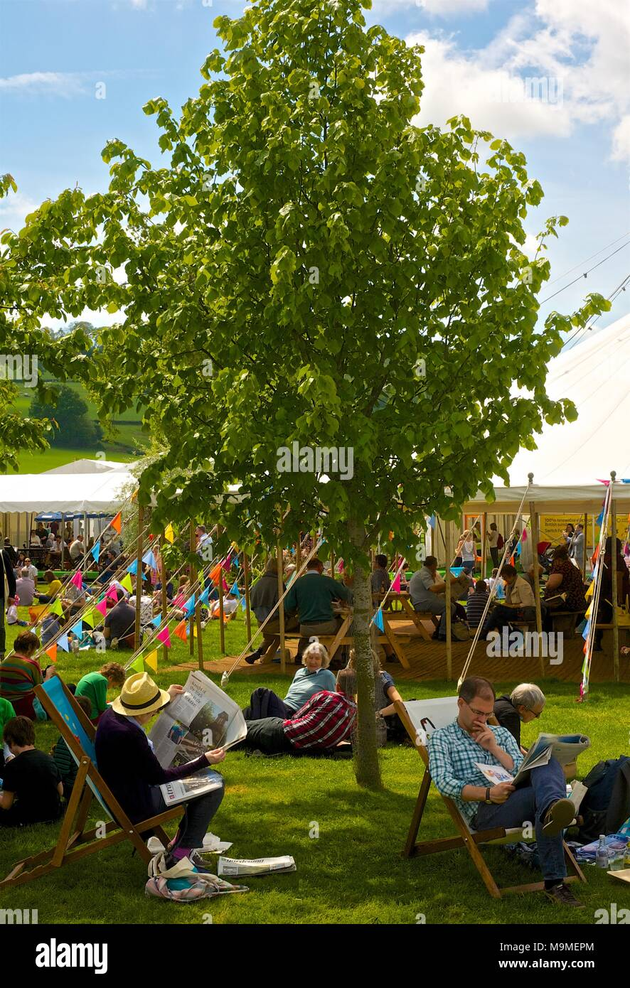 Hay on Wye book festival with people attending Festival events and book signings on a sunny summer day in Wales - Stock Image