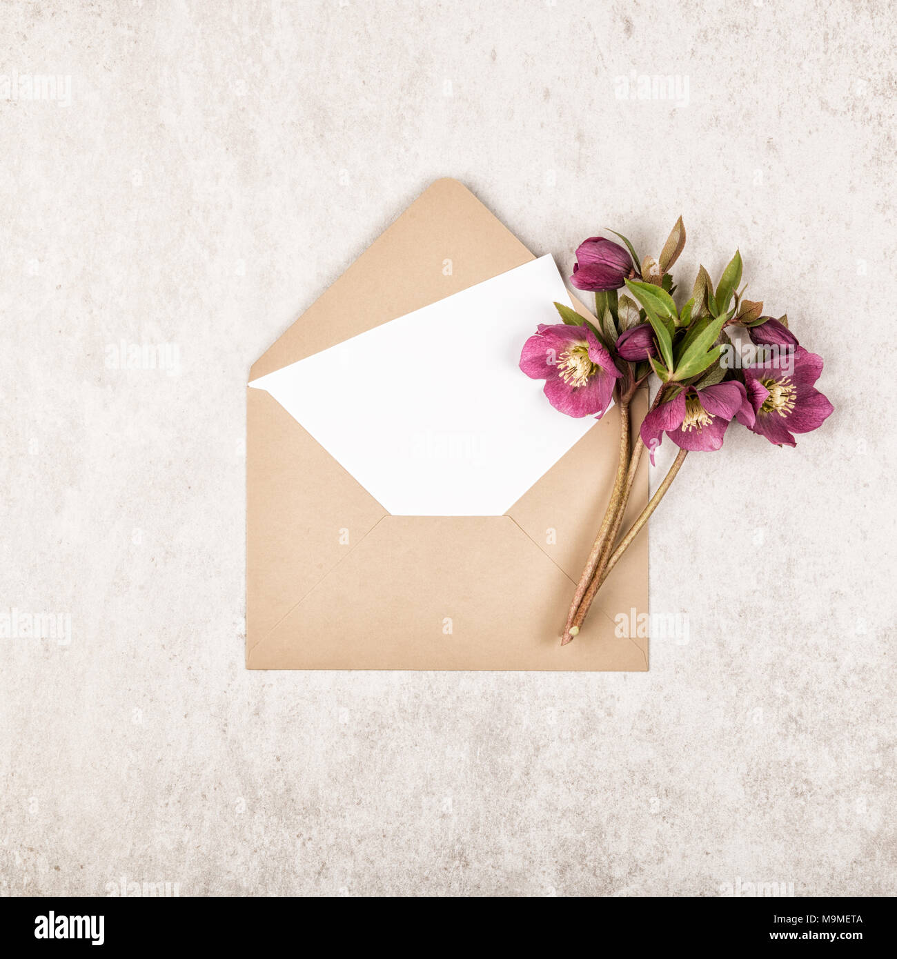 Beige Craft Envelope With Blank White Note Card And Bouquet