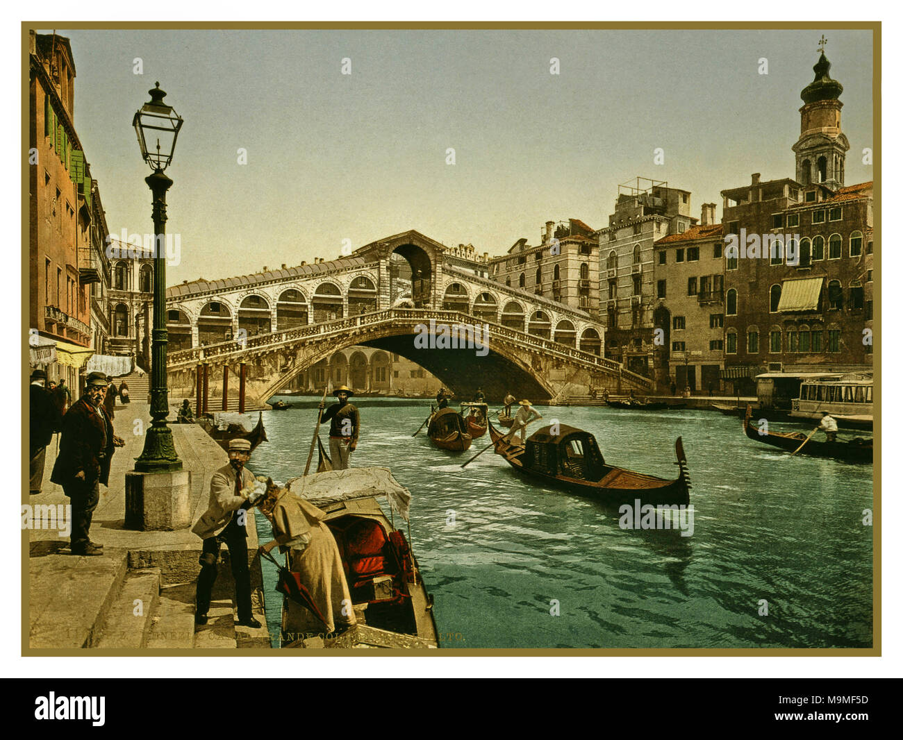 RIALTO BRIDGE VENICE GONDOLA Photochrome 1890-1900's Historic Vintage Old image of The Rialto Bridge, Venice, Italy 1890 Using post colouring technique via transfer onto lithographic printing plates from Black and White negative images - Stock Image