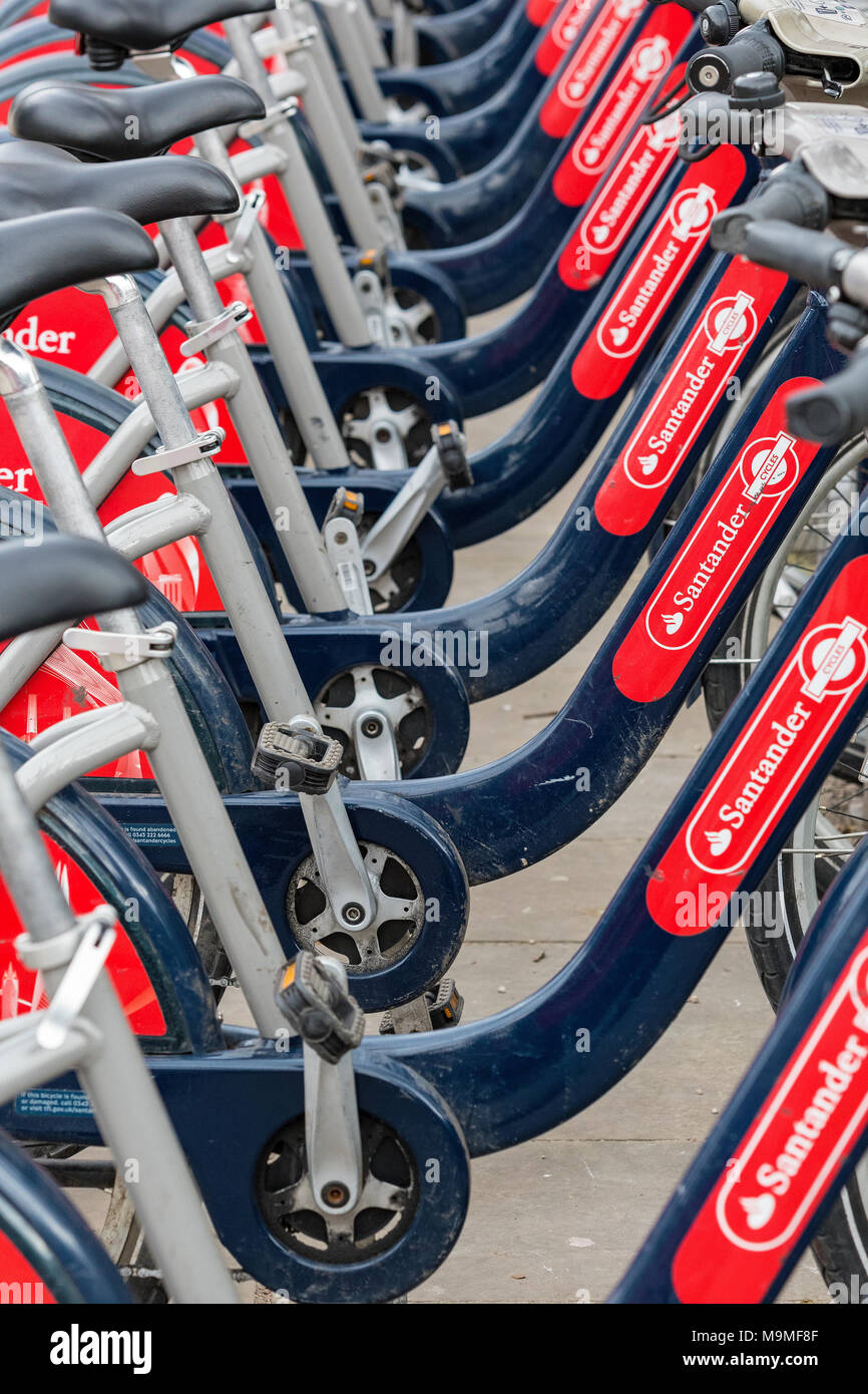 a row or line of boris bikes in central london. Commuting and cycling to work in the city using bikes supplied by TFL or transport fro London,cycles. - Stock Image