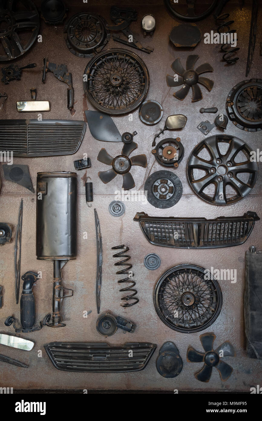 Set of old car parts on the wall in workshop - Stock Image