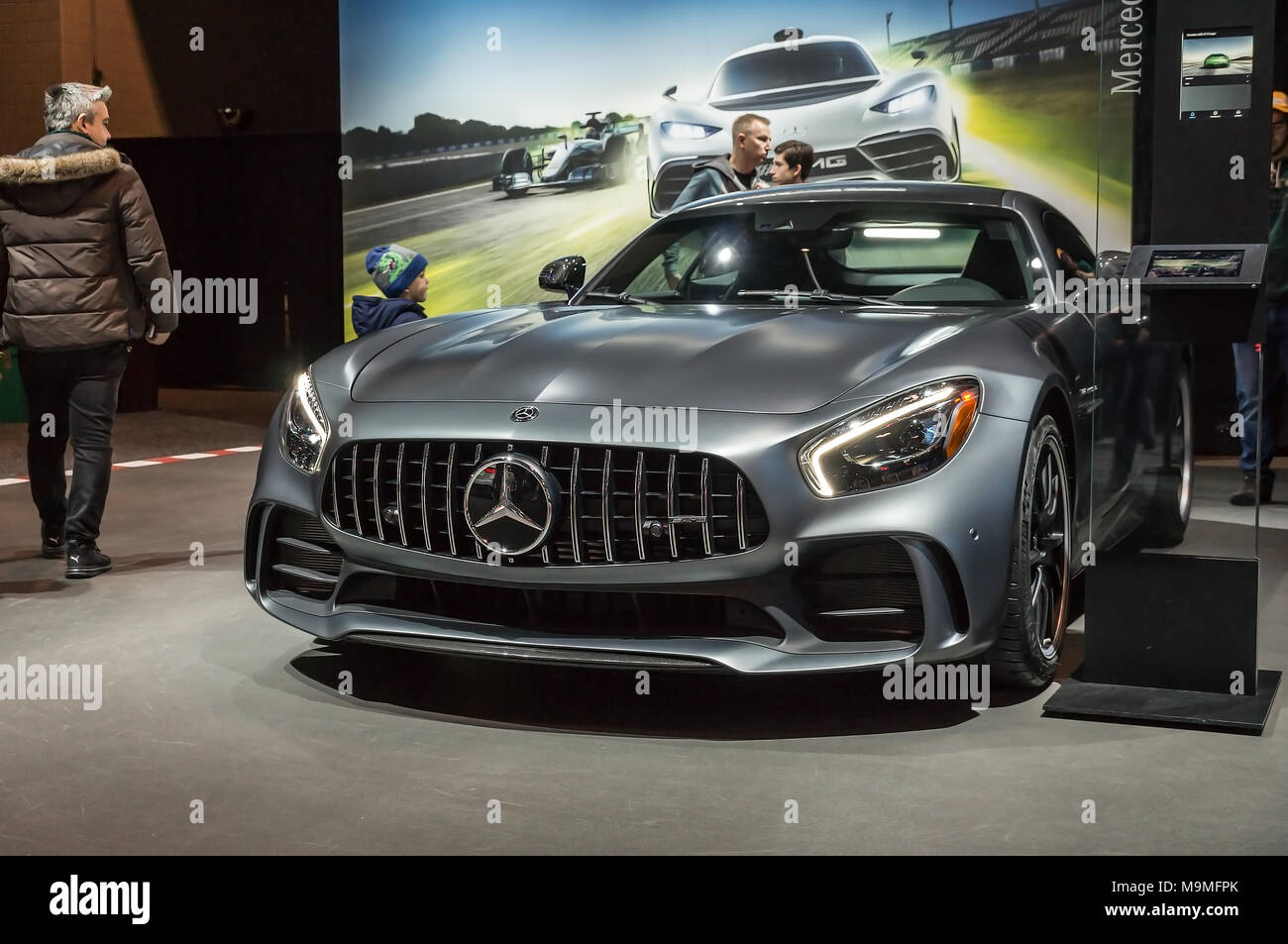 Toronto, Canada - 2018-02-19: Visitors of 2018 Canadian International AutoShow beside the Mercedes-AMG GT R displayed on the Mercedes-Benz exposition - Stock Image