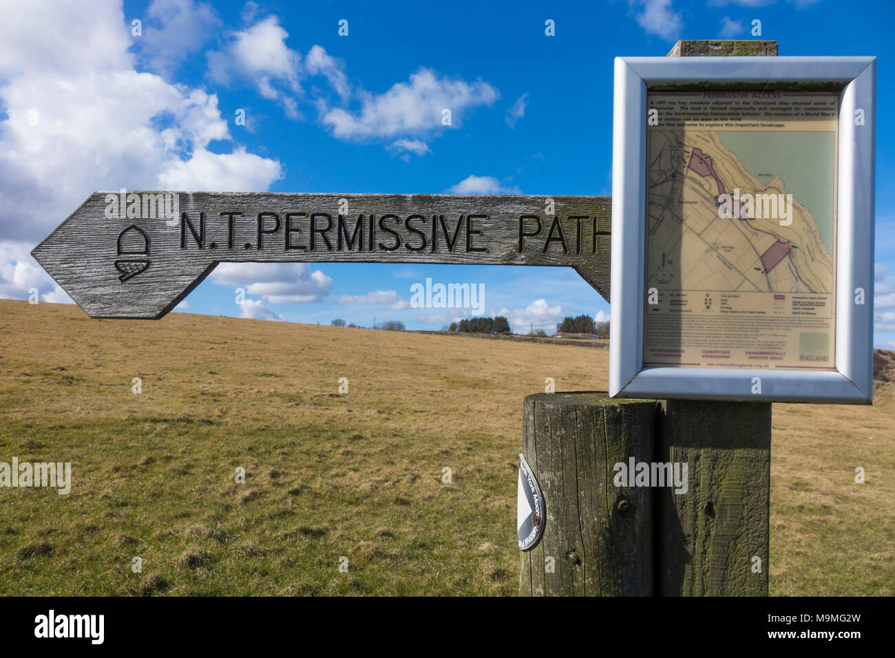 Finger post showing an NT Permissive Path where landowner consents to public access but not a Right of Way field with WW2 Radar Station Ravenscar - Stock Image