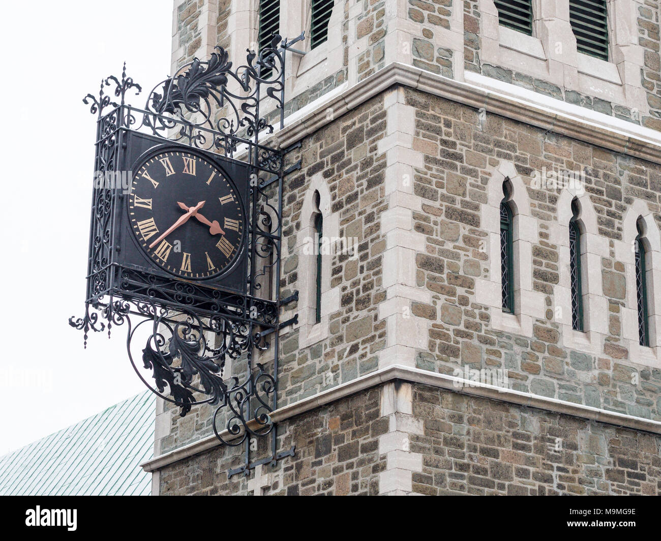 Clock of the Bibliotheque Clare-Martin: This city library occupies the building of the former St. Matthew's Anglican Church formerly known as the library Saint-Jean-Baptiste. - Stock Image