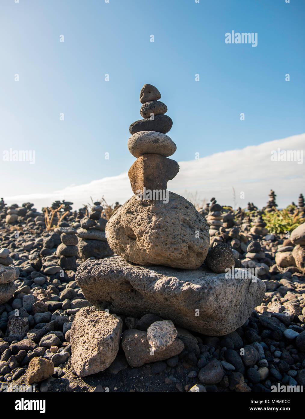 Stacked stones, cairns, pyramids, Playa del Castillo, Puerto de la Cruz, Tenerife, Spain - Stock Image