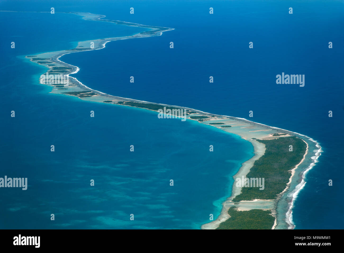 Coral reef with clouds, reef fringes in the sea, Tikehau Atoll, Pacific Ocean, society islands, Windward Islands - Stock Image