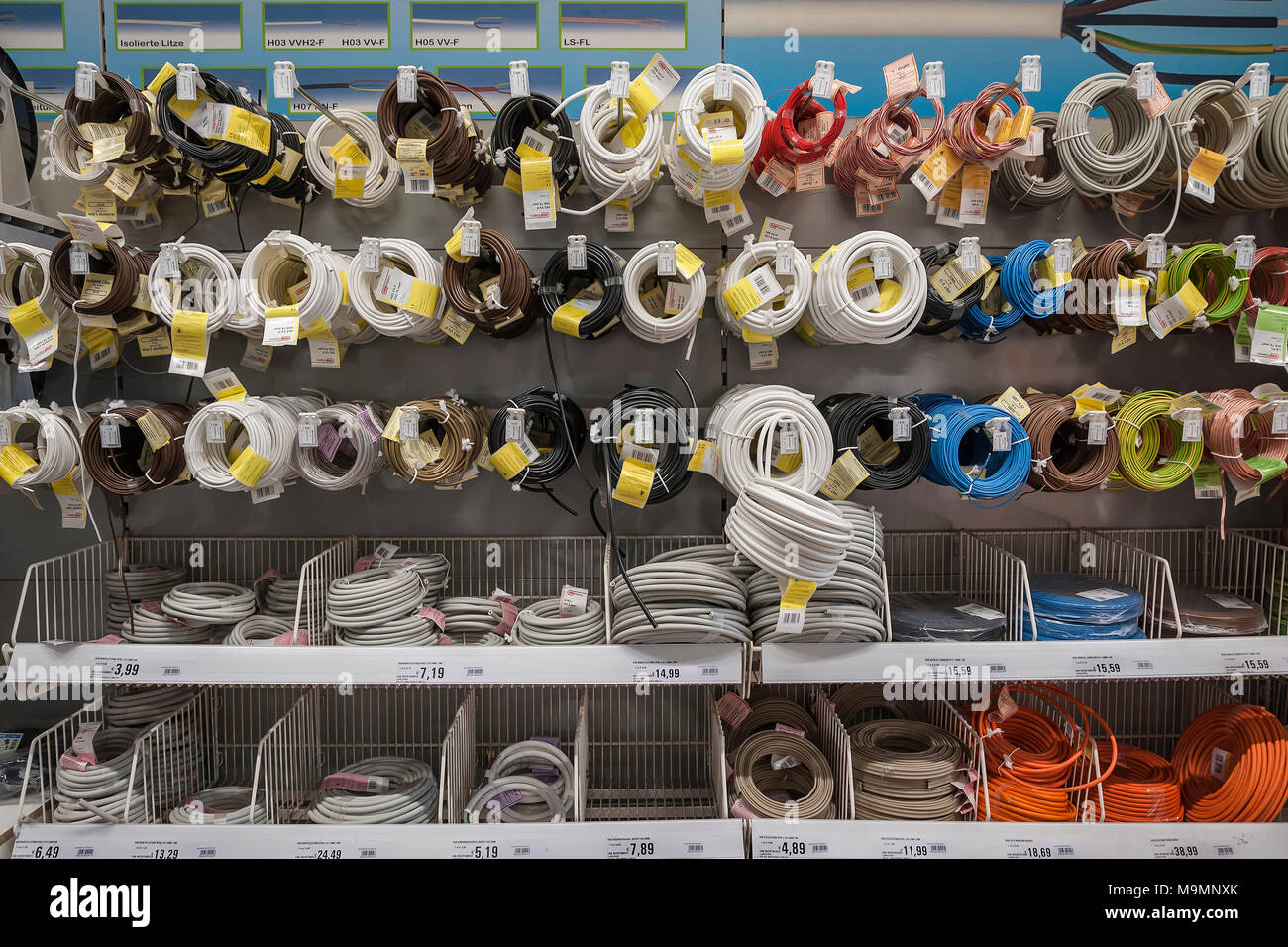 Electrical supplies, electric cables hanging on shelves, hardware store, interior, Bavaria, Germany - Stock Image