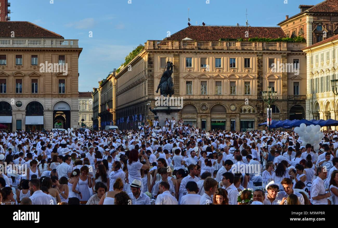 Turin, Italy, Piedmont June 29 2014. The 'dinner in white' event in Piazza San Carlo in Turin. The square is full of people in dress code white. - Stock Image