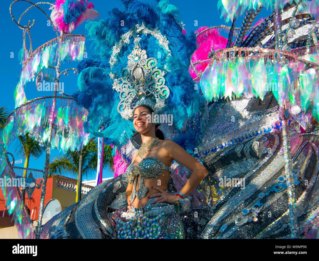 Woman in fanciful costume on carriage, carnival, street carnival, Puerto de la Cruz, Tenerife, Canary Islands, Spain - Stock Image