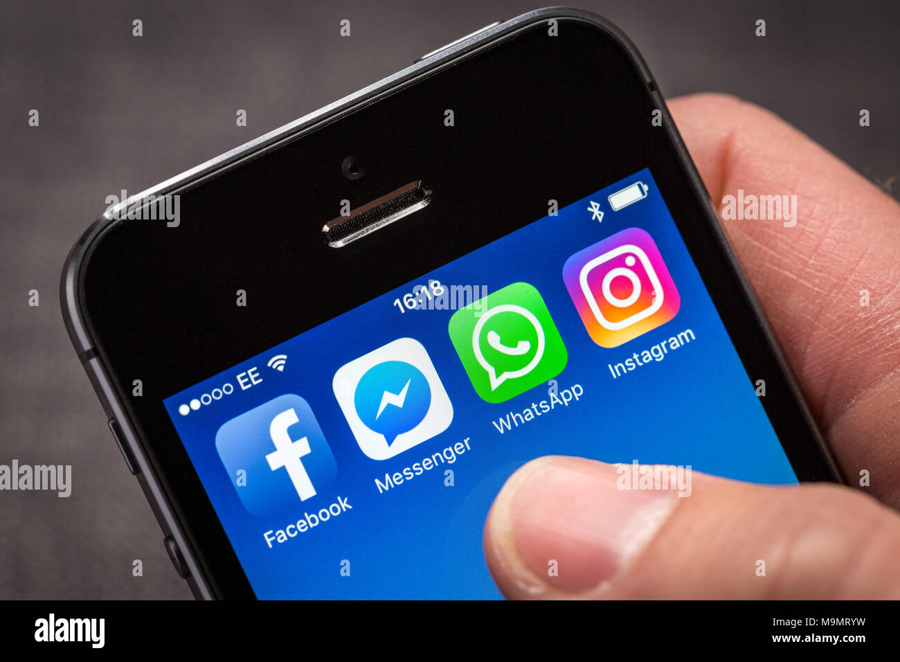 Facebook and associated company apps, Facebook Messenger, WhatsApp and Instagram on an iPhone - Stock Image