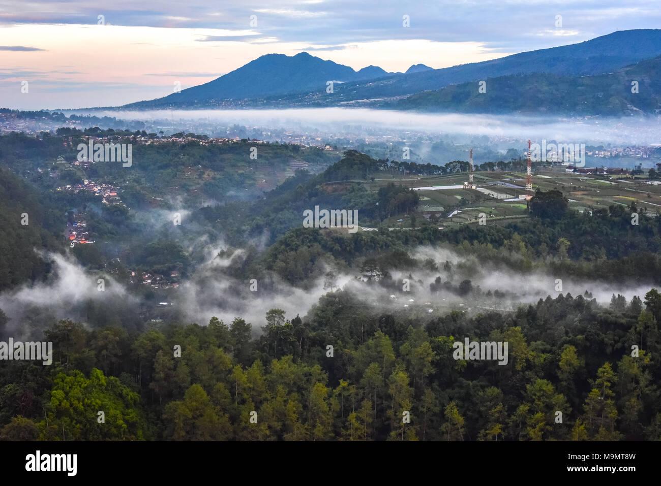 Mount Burangrang, Mount Tangkubanperahu, Lembang Fault, and the city of Lembang in the northern part of Bandung Basin, West Java, Indonesia. - Stock Image
