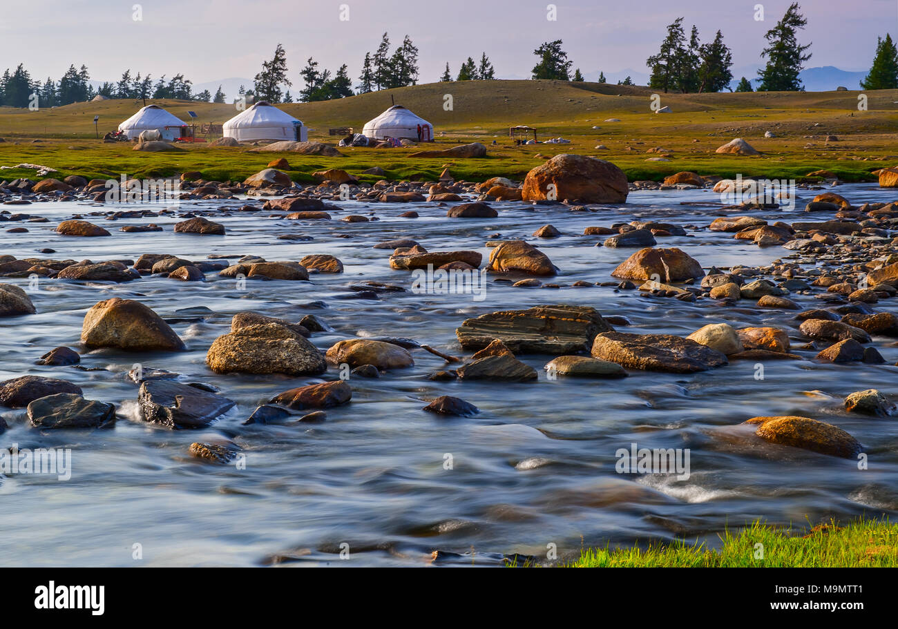 Nomads camp with yurts on the shore of Tuul river, Gorkhi-Terelj National Park, Mongolia - Stock Image