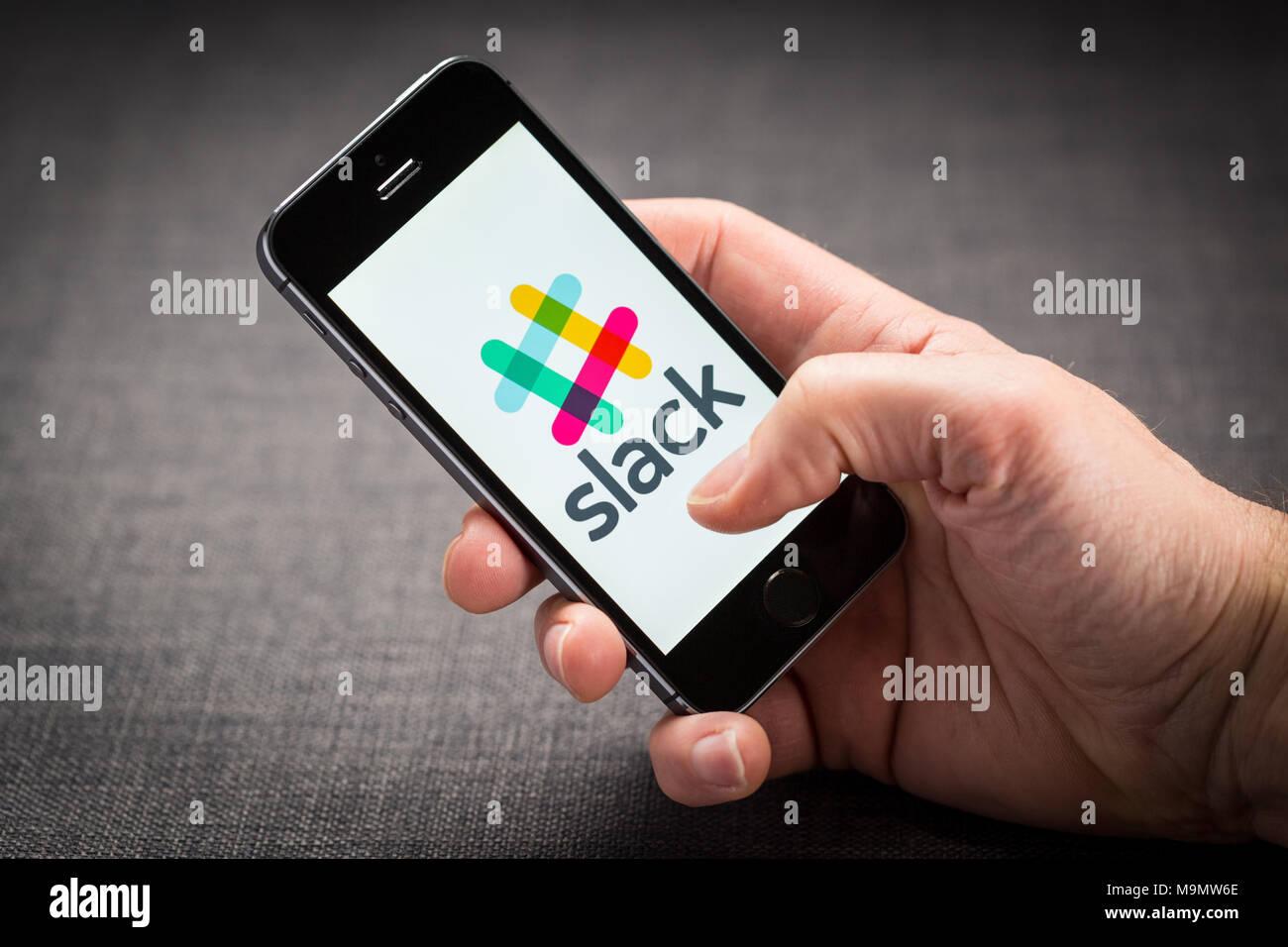 Slack app on an iPhone - Stock Image