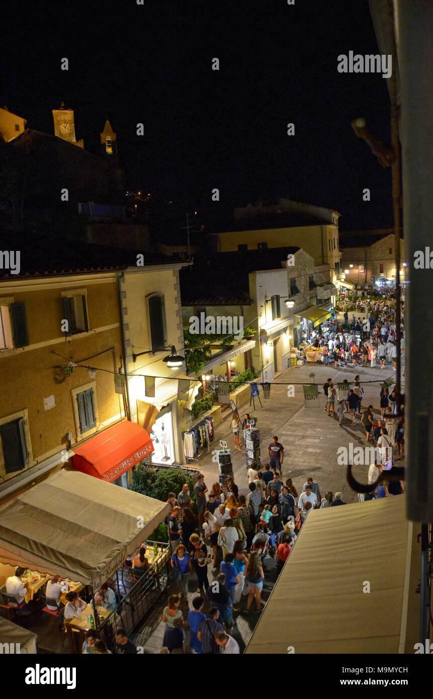 Castiglione della Pescaia, Tuscany, Italy August 22, 2014 hours 23:00. Top view of corso della libertà full of tourists strolling after dinner. - Stock Image