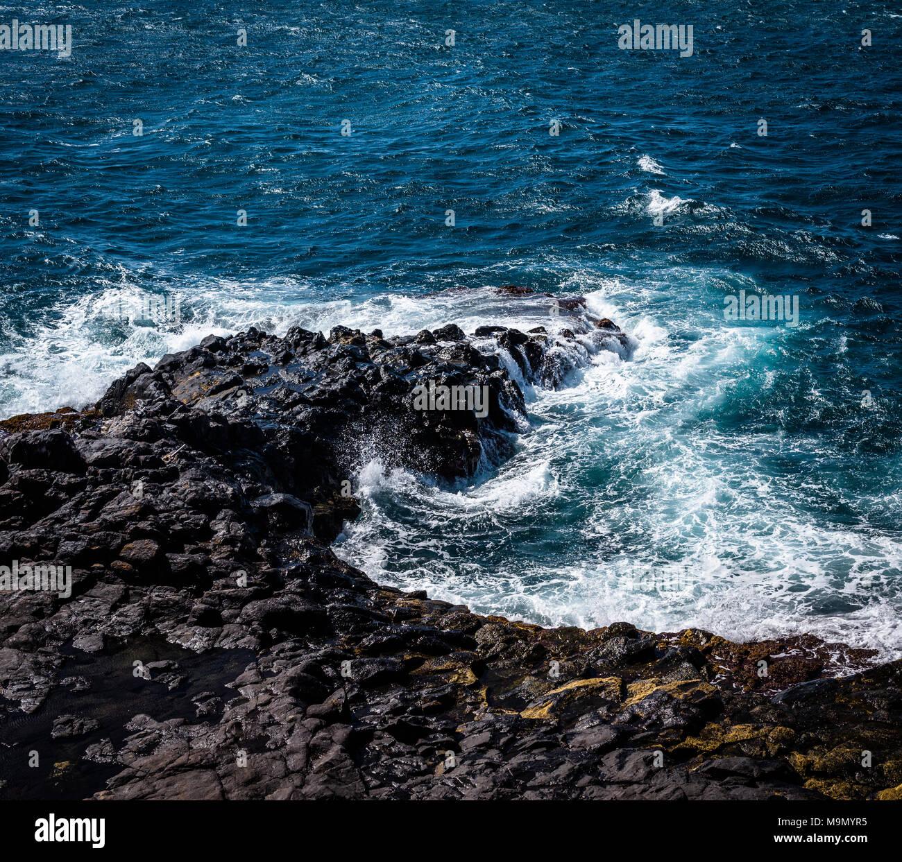 Coastal rocks and waves on Tenerife, Canary Island, Spain. - Stock Image