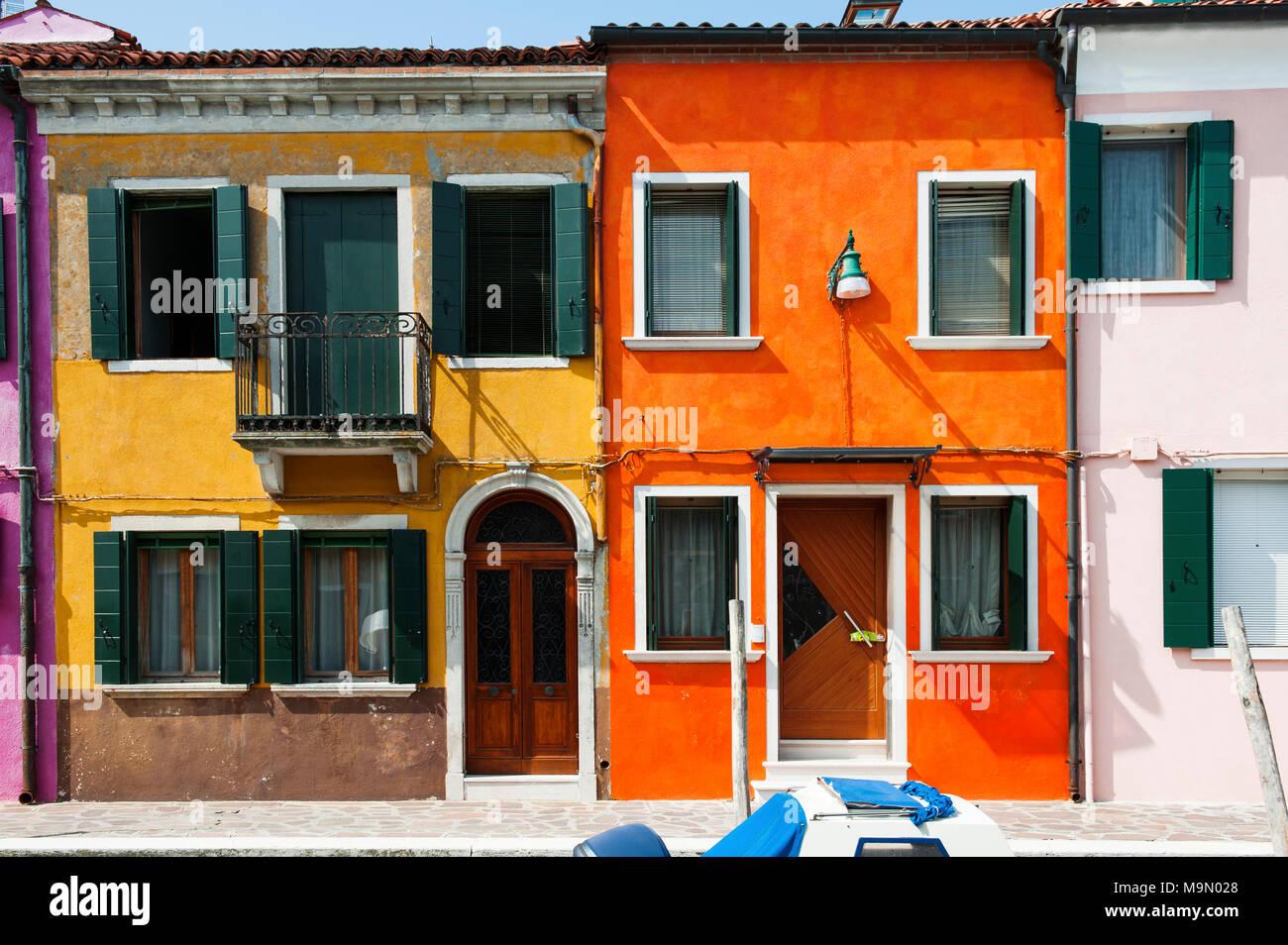 Orange and yellow house in Burano, a little island in Venetian lagoon, Italy, Europe - Stock Image