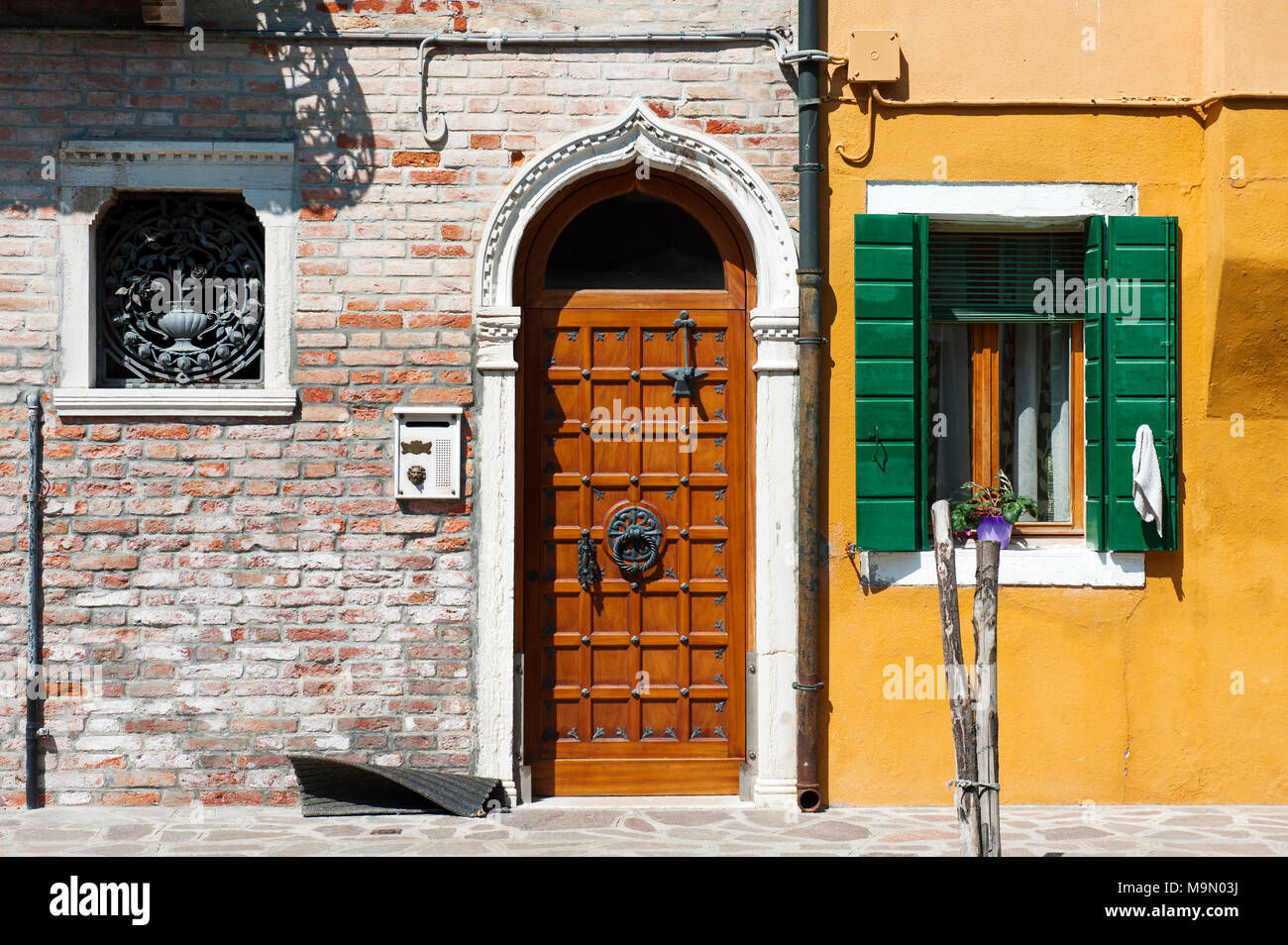 Burano island, Venice, Italy, Europe - a street with colorful houses - Stock Image