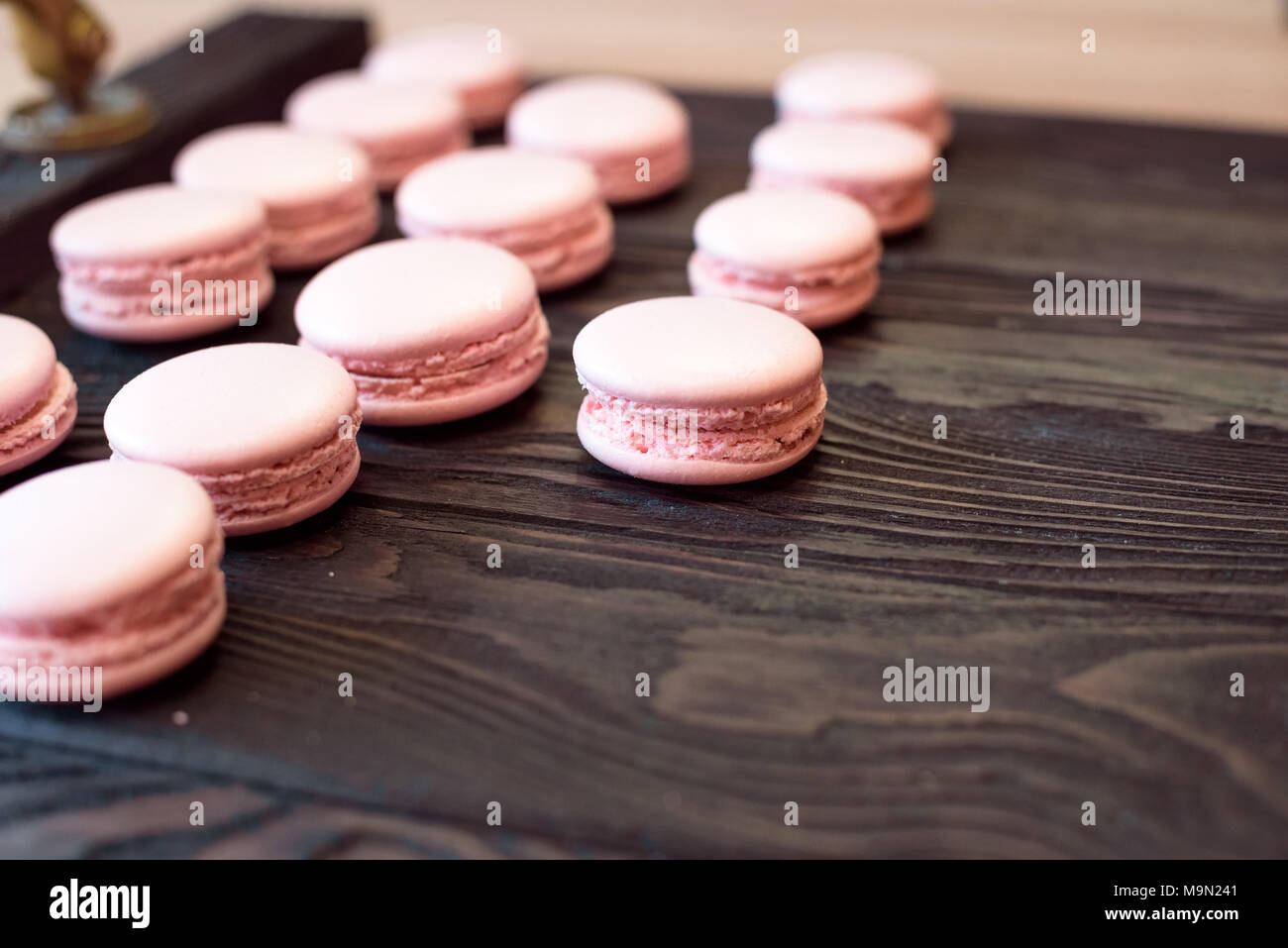 Pink macarons on wooden table Stock Photo