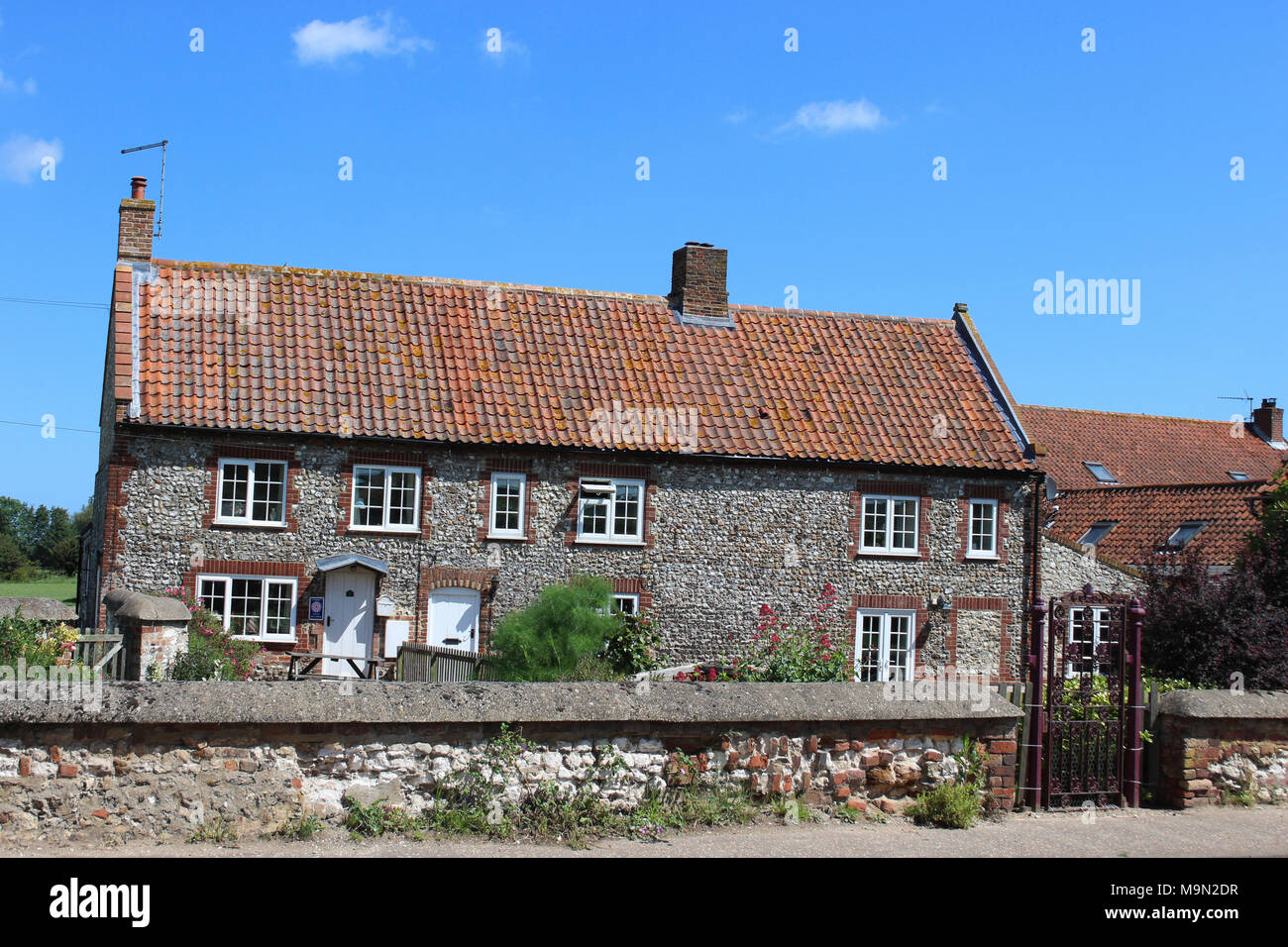 Norfolk Flint Cottages Used As Self Catering Holiday Accomodation - Stock Image