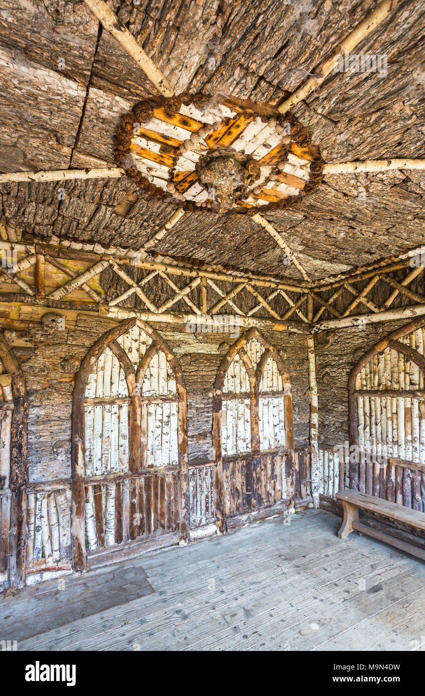 Interior of the Swiss Seat, an unusual restored silver birch wooden summerhouse kiosk in the gardens of Frogmore House, Frogmore Estate, Windsor, UK - Stock Image