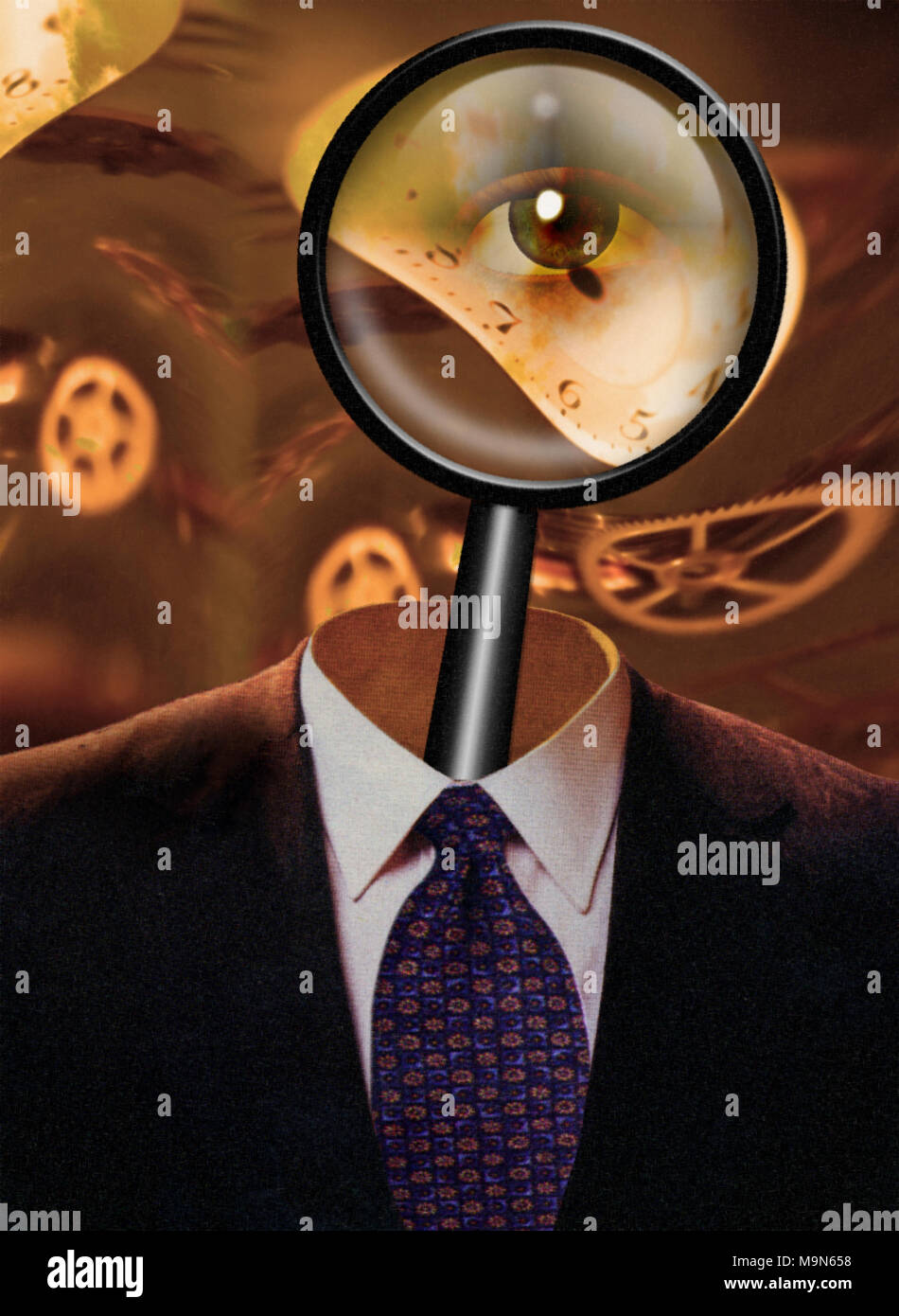 Magnify glass in man's suit - Stock Image