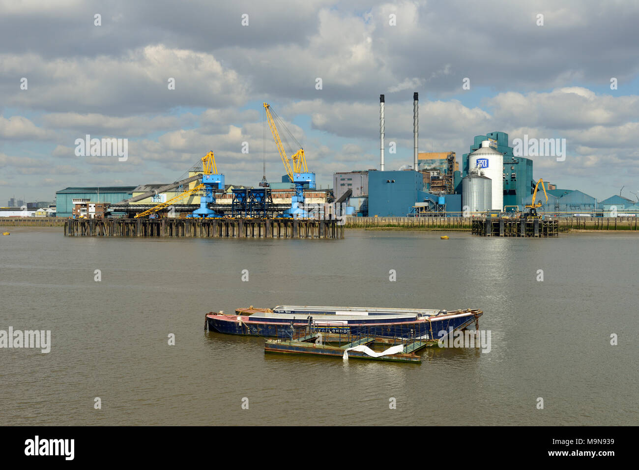 Tate & Lyle sugar refinery, Thames River, East London, United Kingdom - Stock Image