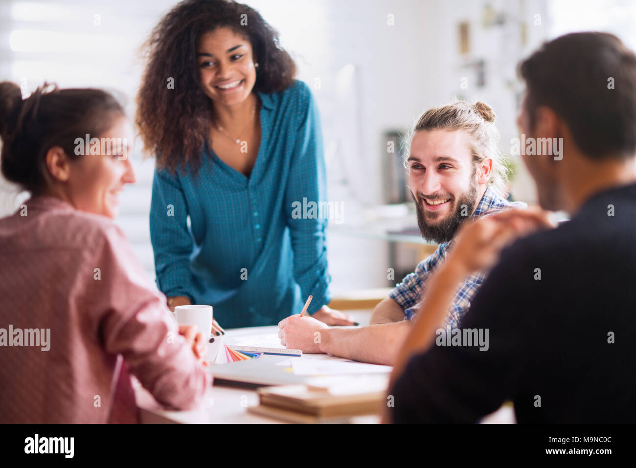 Meeting at office. a blackwoman discusses with her colleagues  - Stock Image