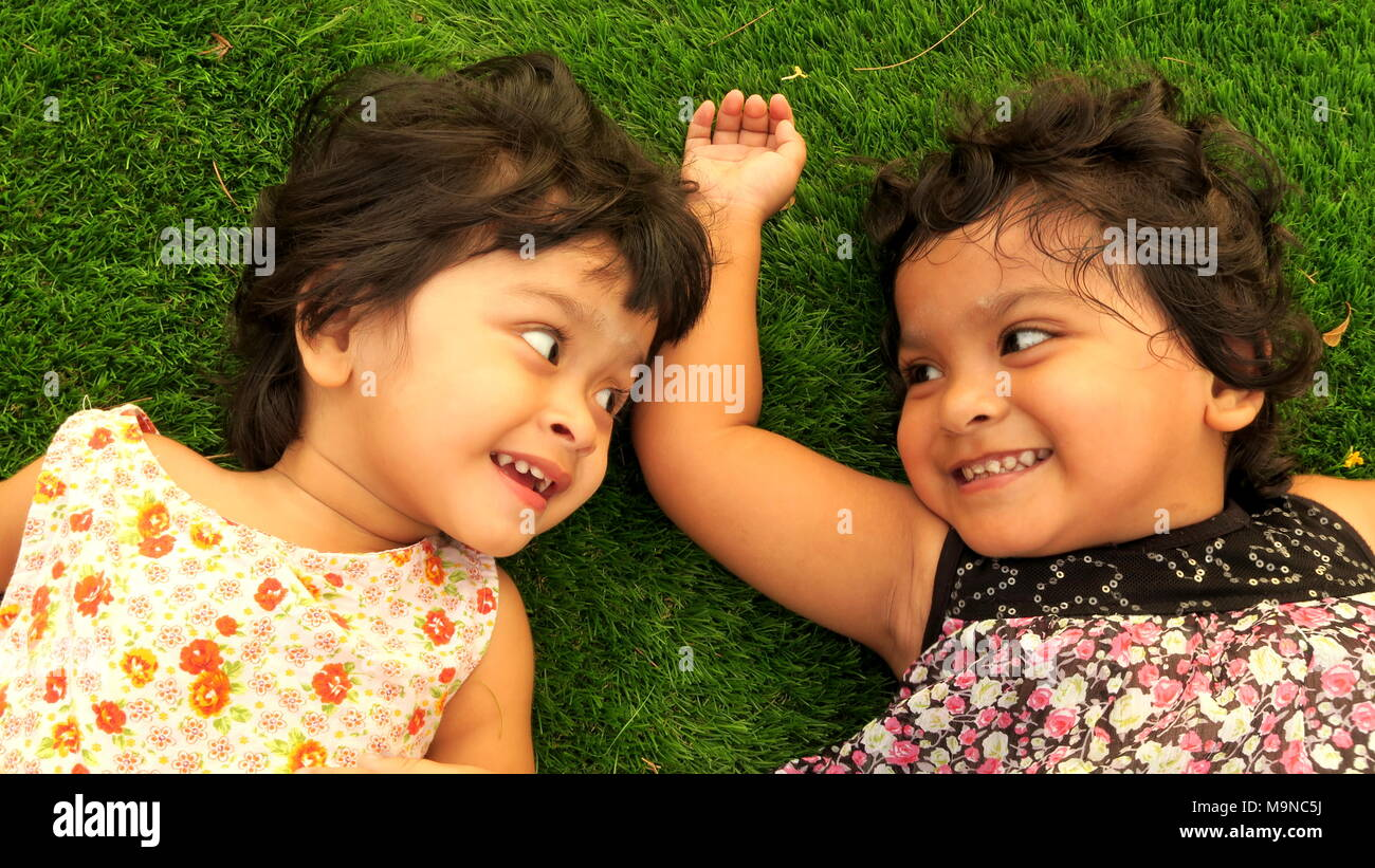 Laughing little cute girls - Stock Image