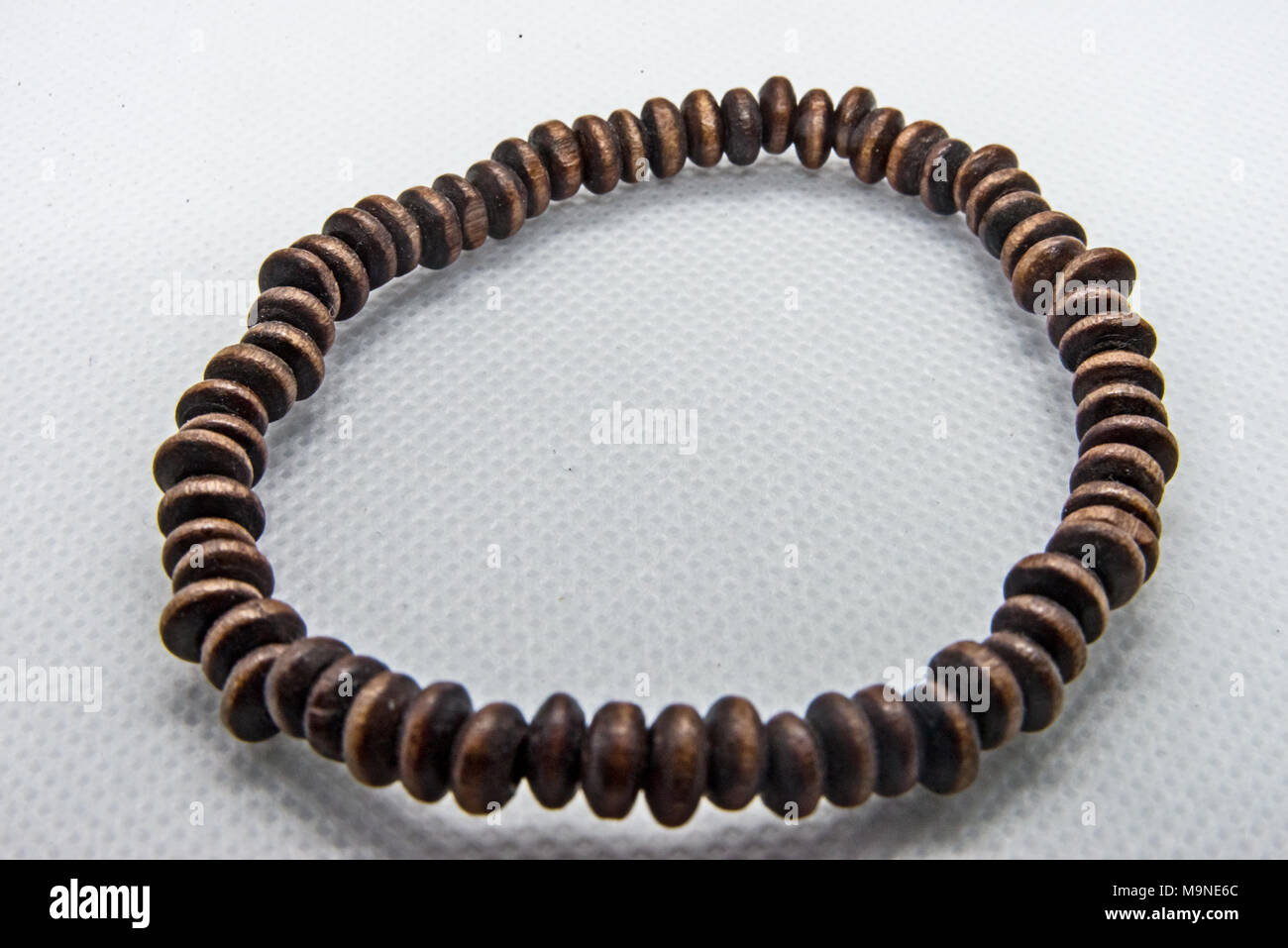 Brown Wooden bangle - Stock Image
