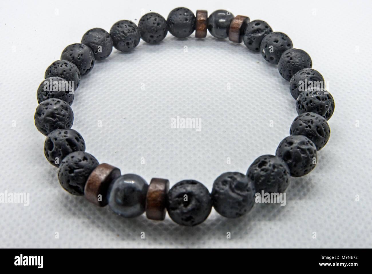 Bangle made of black stone - Stock Image