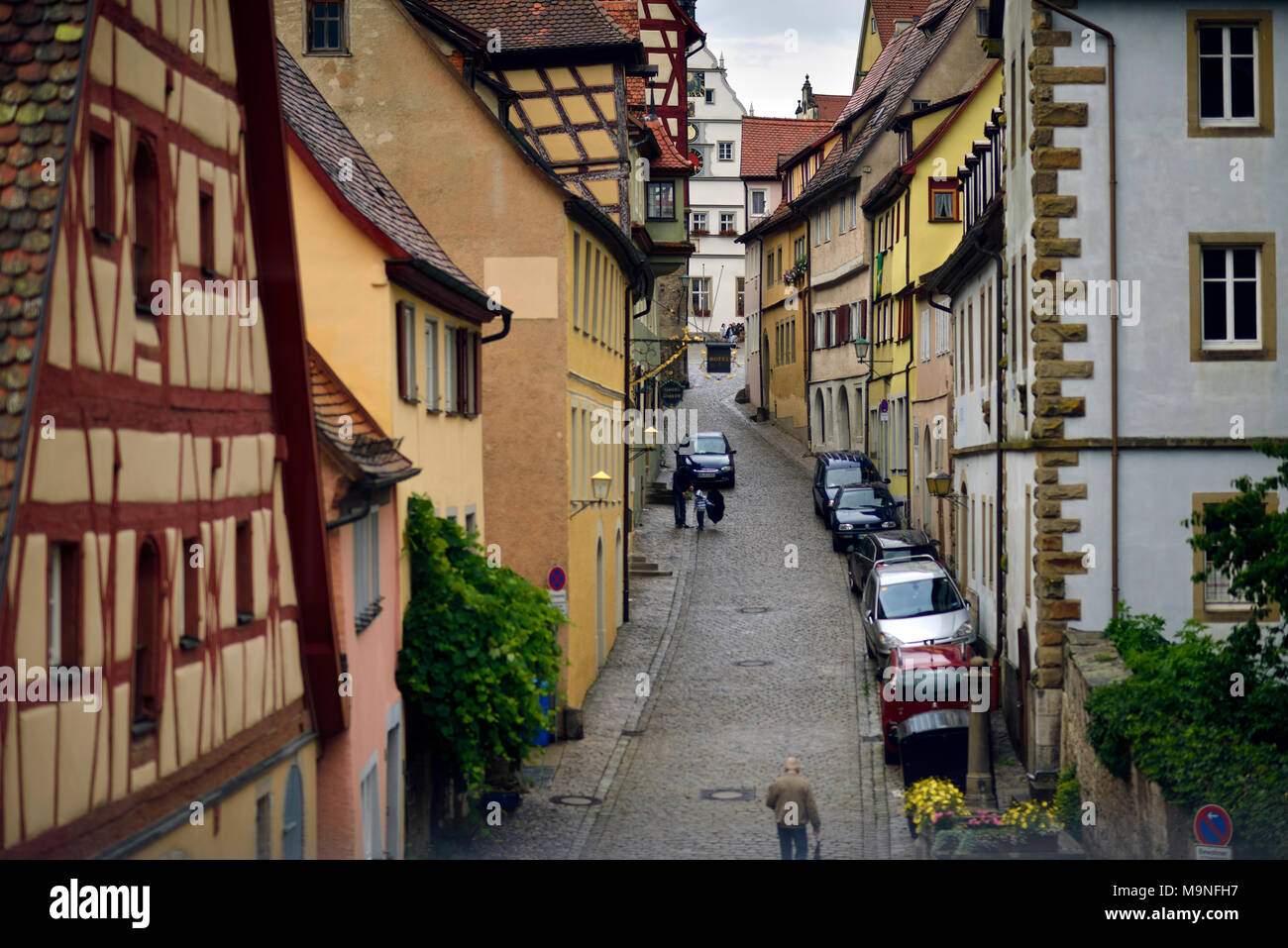 A view of a street in the medieval town of Rothenburg ob der Tauber, Germany. - Stock Image