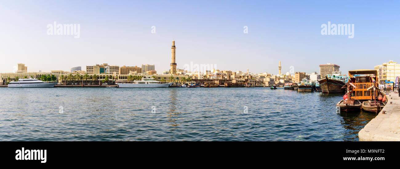 Dubai Creek panorama with views over to the Grand Mosque Minaret, Dubai Creek, Dubai, UAE - Stock Image