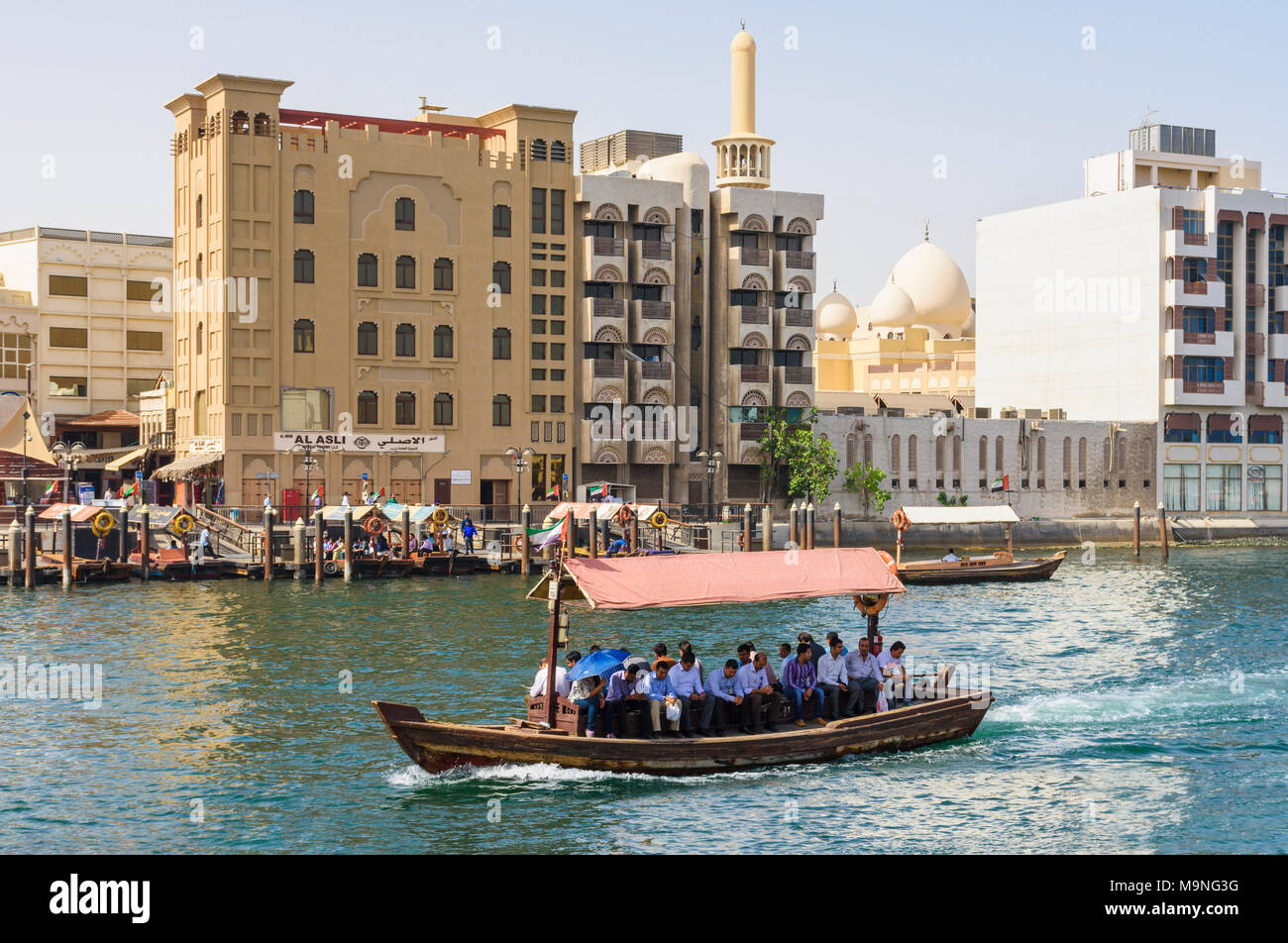 Dubai Creek abra boat with views over to Bur Dubai, Dubai Creek, Dubai, UAE - Stock Image